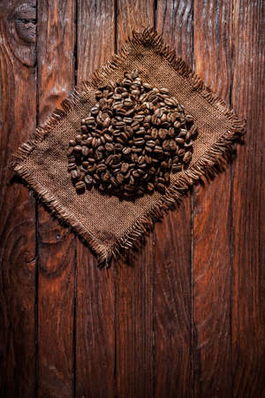 Coffee beans on a wooden background