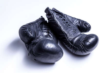 Old boxing gloves on a white background