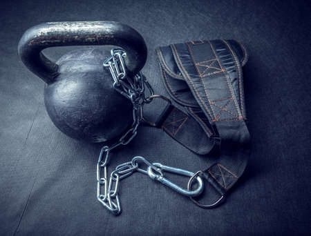 Sports belt with chain and kettlebell