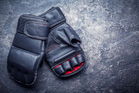 Mixed martial arts black gloves on gray background