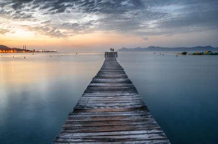 Majorca Puerto de Alcudia beach pier at sunrise in Alcudia bay in Mallorca Balearic islands of Spain Imagens