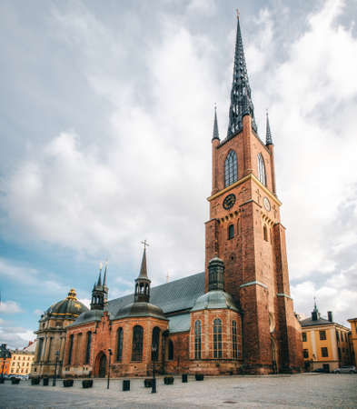 Riddarholmskyrkan Church at the sunny day on Birger Jarls torg in Stockholm, Sweden Stock Photo