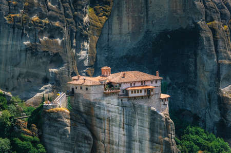 Meteora, Greece. Mountain scenery with Meteora rocks and Roussanou Monastery, landscape place of monasteries on the rocks, orthodox religious greek landmark in Thessaly
