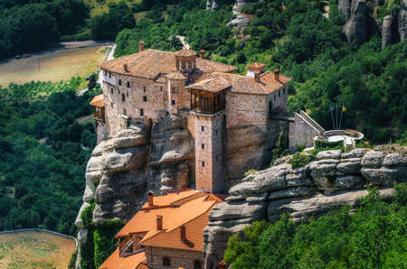 thessaly: Mountain scenery with Meteora rocks and Roussanou Monastery, landscape place of monasteries on the rocks, orthodox religious greek landmark in Thessaly, Meteora, Greece
