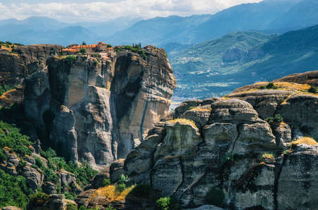 thessaly: View of The Holy Monastery of St. Stephen at the complex of Meteora monasteries in Greece. Steep cliffs and mountains in the valley of Thessaly
