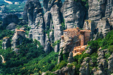 thessaly: Meteora, Greece. Mountain scenery with Meteora rocks and Roussanou Monastery, landscape place of monasteries on the rocks, orthodox religious greek landmark in Thessaly