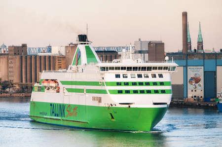 HELSINKI, FINLAND - MARCH, 17, 2015: Passenger ferry sails against industrial port Lansiterminaali in Helsinki, Finland