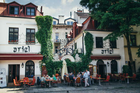KRAKOW, POLAND - JUNE 26, 2015: People in the open Ariel Jewish restraurant in Kazimierz