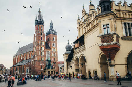 assumed: KRAKOW, POLAND - JUNE 27, 2015: Church of Our Lady Assumed into Heaven (St. Marys Church) in Krakow and Sukiennice museum. Medieval city center.