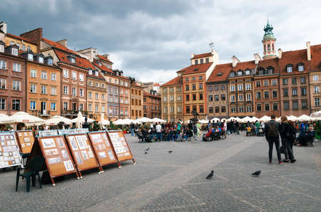 Warsaw, Poland - May 28, 2015: Paintings and pictures art for sale on the Old Town Market Place square.