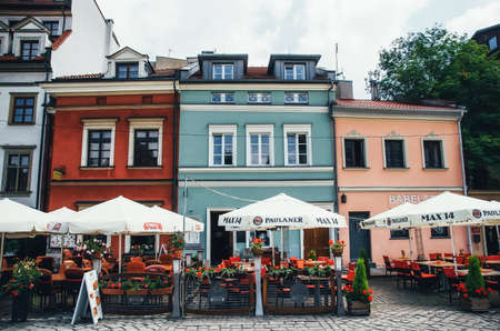 Krakow, Poland - June 26, 2015: Open cafe restaurant in Jewish quarter of Kazimierz on Szeroka street against colorful old houses
