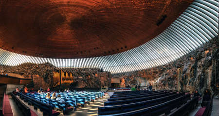 Helsinki, Finland - March, 17, 2015: Interior of the Rock Church Temppeliaukio Church with pipe organ and copper ceiling dome in the center of the Helsinki City, Finland.