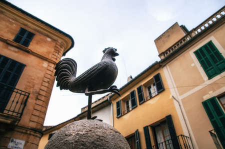 gall: Pollensa, Mallorca, Spain - May 24, 2015: Cock area or La Font del Gall in the center of Pollensa in Mallorca. The Rooster it is symbol of Pollensa Stock Photo