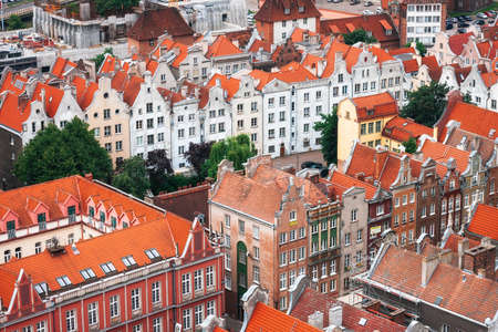 Red roofs, old buildings and colorful houses in Old Town Stare Miasto in Gdansk, aerial view from cathedral St. Marys Church tower, Poland