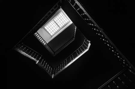 attic window: Outlines of the square staircase in building in low light with attic window. Bottom view Stock Photo