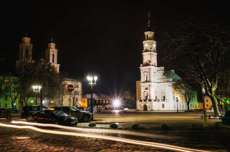 kaunas: The Town Hall in Old Town of Kaunas with St. Francis Xavier Church at night, Lithuania