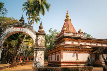 shree: Morjim, Goa, India - December 08, 2014: Ancient Hindu Shree Morjai Temple at Morjim amidst a coconut grove. In the temple celebrate Kalas Utsav. The walls are adorned with the rare and extinct Kaavi art friezes