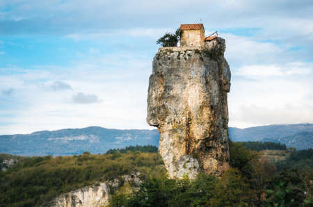 Katskhi pillar. Georgian landmarks. Mans monastery near the village of Katskhi. The orthodox church and the abbot cell on a rocky cliff. Imereti, Georgia. Georgian Meteora