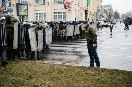 against the current: Minsk, Belarus - March 25, 2017 - Special police unit with shields against protesters. Belarusian people participate in the protest against the decree 3 Lukashenko and the current authorities. Editorial