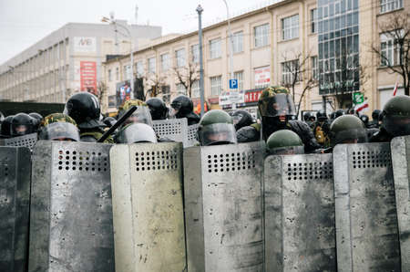 police unit: Minsk, Belarus - March 25, 2017 - Special police unit with shields against protesters. Belarusian people participate in the protest against the decree 3 Lukashenko and the current authorities. Editorial