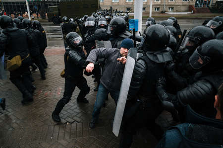 police unit: Minsk, Belarus - March 25, 2017 - Belarusian people participate in the protest against the decree 3 On prevention of social parasitism of President Lukashenko and the current authorities.