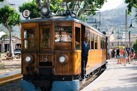 Port de Soller, Mallorca, Spain - May 26, 2016: Tram in the railway station of Soller. Travel attraction of Mallorca. A vintage tram runs from Palma to Soller