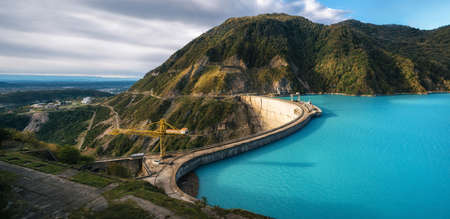 The Enguri hydroelectric power station HES. The wide Inguri River Jvari Reservoir next to Enguri Dam, surrounded by mountains, Upper Svaneti, Georgia. One of the highest concrete arch dam in the world. Jvari location. Stock Photo