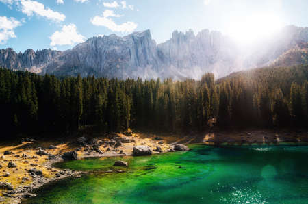 Karersee or Carezza Lake in Dolomites in South Tyrol in autumn at sunset, Italy. Stock Photo
