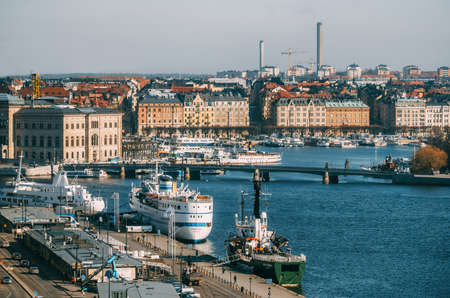 Stockholm, Sweden - March, 18, 2015: View of Strommen of Saltsjon bay with nautical vessels and old buildings from Katarina elevator Editorial