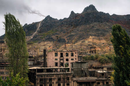 Alaverdi copper-chemical smelter. Abandoned copper and molybdenum refinery with smoking pipe on top of mountain in Armenia