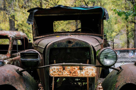 Pasanauri, Georgia - October 21, 2016: Old rusted out scrap retro car Ford AA or Gaz AA 1920s and 1930s that has been abandoned in forest woods