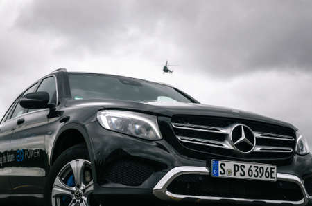 Minsk, Belarus - August 26, 2017: Front view of Mercedes-Benz GLC 350 e Plug-In Hybrid against the helicopter in the sky.