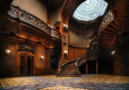 Lviv, Ukraine - 23 septembre 2016 : Maison des scientifiques. Intérieur du magnifique manoir avec grand escalier en bois orné dans le grand hall. Un ancien casino national.