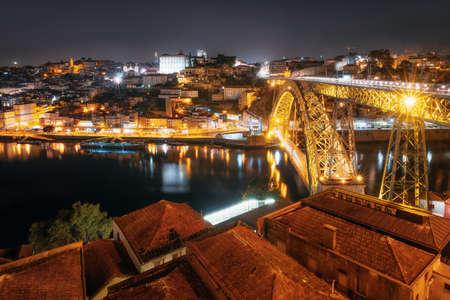 Porto cityscape over the Douro River and Dom Louis I Bridge at night, Portugal