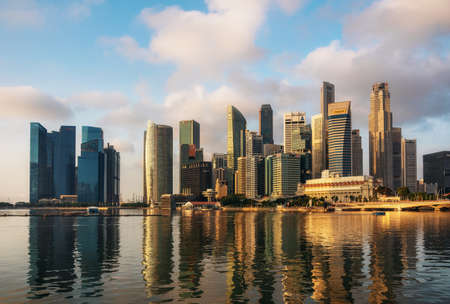 Singapore,Singapore May 9 2016 : Singapore business district with skyscrapers and reflection at Marina Bay at sunrise, Singapore.