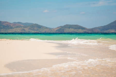White beach with turquoise water and sandbar, Bulog island, Philippines.