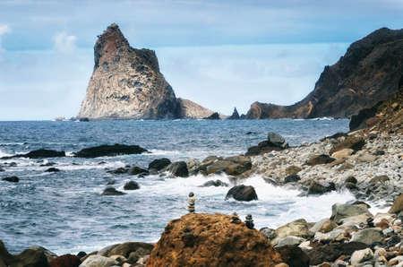 Powerful ocean waves crashing on jagged rocks in wild Benijo beach, Tenerife, Canary island, Spain