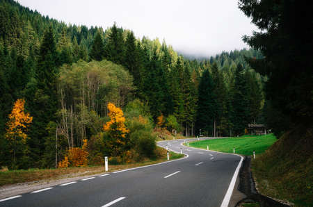 Winding road in dense forest in area of Dachstein massif in Alps, Austria Imagens