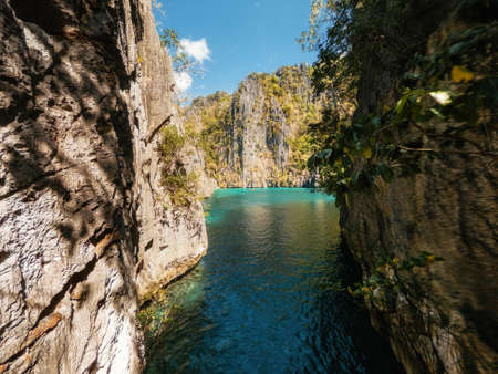 View to tropical Twin lagoon with azure water between rocks, Coron island. Palawan, Philippines.