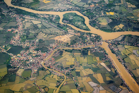 Aerial landscape village countryside in Luzon island with green rice paddy fields and rivers background, Philippines