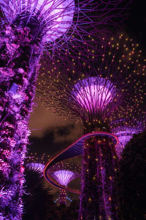 Singapore - April 2, 2018: Light show of Giant trees at Garden by the bay at night in Singapore. Editorial