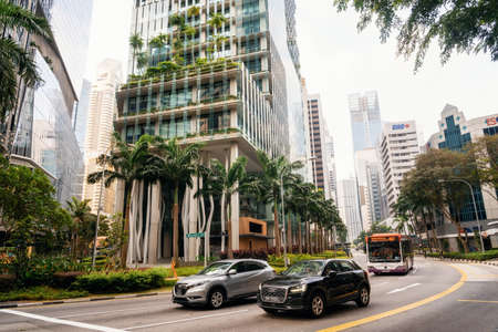 Singapore - May 9, 2016 : Capitagreen modern glass building with garden on facade in Singapore Editorial