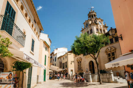 Alcudia, Mallorca, Spain - May 23, 2015: Architecture of Majorca. The tower with big clock of City town hall in Old Town of Alcudia, Mallorca, Balearic island, Spain