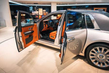 Munich, Germany - December 7, 2017: Interior view of luxury Rolls Royce Phantom VIII 8 car with opened doors, dashboard and steering wheel Editorial