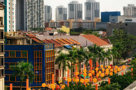 Chinatown, Singapore - February 8, 2019: Aerial view of Chinatown with red roofs and Central Business District