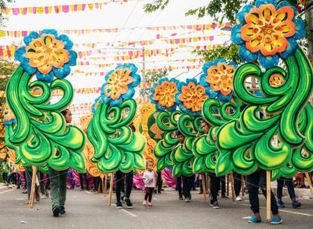Cebu City , The Philippines - January 20, 2019: Street dancers in vivid colorful costumes participate in the parade at the Sinulog Festival. Redakční