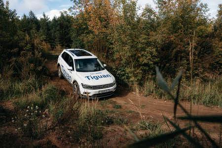 Minsk, Belarus - September 20, 2019: Volkswagen Tiguan 4x4 rides cross country in forest. Editorial