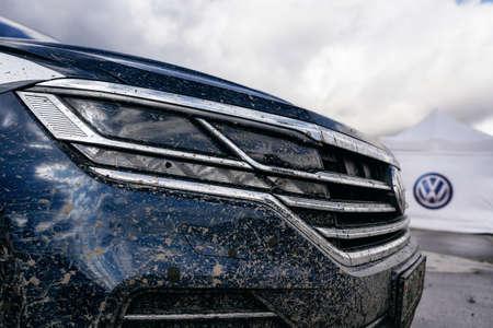 Minsk, Belarus - September 20, 2019: Closeup dirty headlight of Volkswagen Touareg Third generation 2019 after off road trip