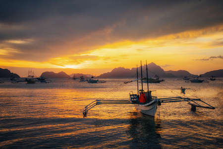 Traditional philippine boats in Corong-Corong beach in El Nido at sunset lights. Palawan island, Philippines Reklamní fotografie - 148276863