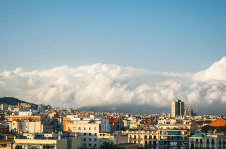 Clouds above Barcelona skyline at sunset, Spain